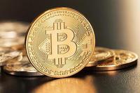 比特币升破11,000美元 加密货币在市场动荡之际走高