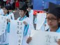 南京百名小学生穿汉服写书法致敬先人