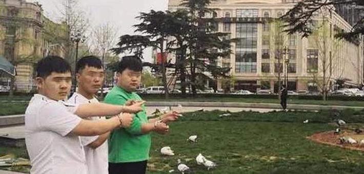 三男子射杀中山广场鸽子被抓获