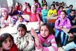 伊拉克学生返校 小学生每周上一天课