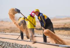 Workers stationed in China's Inner Mongolia for railway sand control