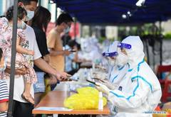 Guangzhou holds new round of mass testing in high-risk areas