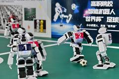 Students take part in robot football match in Beijing