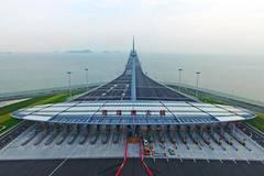 World's longest cross-sea bridge opens to public traffic