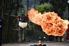 Fire-spewing drone cleans garbage on power lines in Chongqing