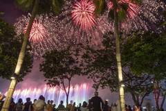 People crowd around Marina Bay to view fireworks performance in Singapore