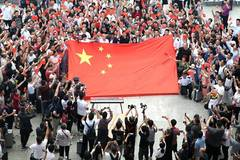 People take part in flash mob in Shanghai to celebrate 70th anniversary of PRC founding