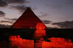 Egypt's Pyramids, Sphinx shine in red to mark Chinese New Year