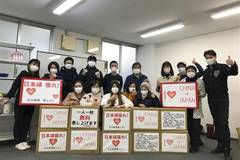 Chinese volunteers distribute masks to local Japanese in Nagoya to help with COVID-19 prevention