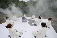 Tai Chi master leads lake performance