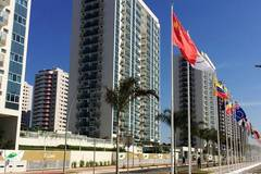 Chinese athletes move to Olympic Village