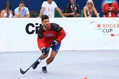 Djokovic competes during Ball Hockey Challenge game in Canada