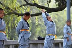 Kung fu kids show off their pre-performance routines