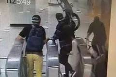 Foreigners dodging fares and taking bikes into Shanghai Metro station stopped