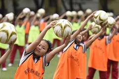 Students do football exercises in Hohhot, N China's Inner Mongolia
