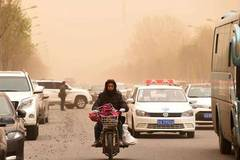 Sandstorm, strong wind hit NE China's Changchun