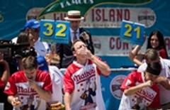 Chestnut's champ again at hot dog eating contest