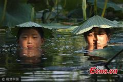 Anything goes as a hat in China's hot summers
