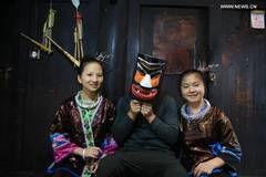 Renowned craftsman makes masks of