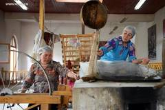 Etles silk production craft revived in China's Xinjiang
