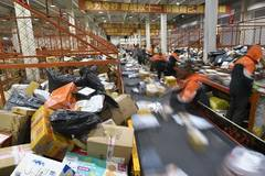 Couriers busy dealing with packages after China's Singles' Day