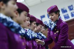 High-speed train stewardesses receive training in SW China