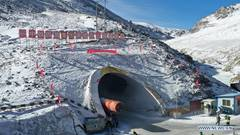 Gansu's Dongshan tunnel at average altitude of 3,850 meters drilled through