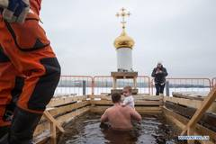 People bathe in icy water during Orthodox Epiphany celebrations in Russia