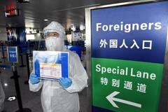 China fights novel coronavirus on two fronts