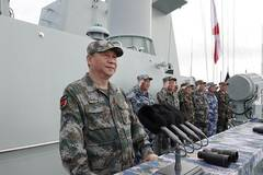 Xi reviews navy in South China Sea