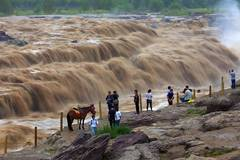 Water volume of Hukou Waterfall surges due to heavy rainfall