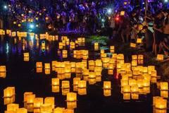 People attend Water Lantern Festival in Los Angeles