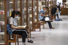 People read books at library during holiday in Taiyuan, Shanxi