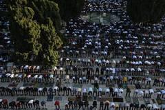 Muslim worshippers pray as they mark Eid al-Adha in Jerusalem's Old City
