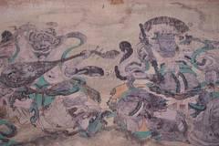 Staff worker restores frescoes in Arjai Grottoes in Inner Mongolia
