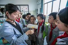 Environmental awareness activity held at Zhejiang's primary school to mark upcoming Earth Day