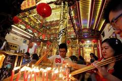 People pray on first day of Chinese Lunar New Year in Yangon, Myanmar
