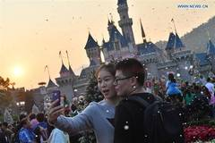 Tourists enjoy themselves at Hong Kong Disneyland Resort