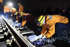 Railway workers work at night in Nanning, S China