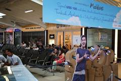 Tourists take rest at airport during state of emergency in Male, Maldives