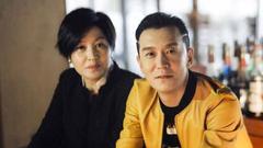 李咏去世后妻子哈文发文:我和女儿会坚强