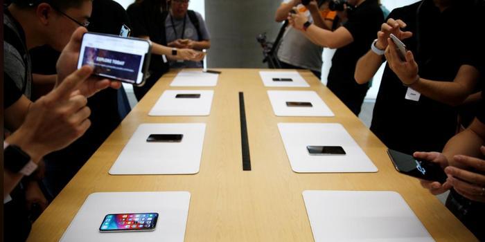 苹果销售好转吸引投资人回归 市值再度逼近万亿美元