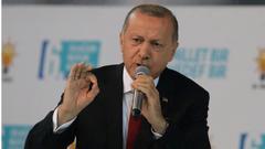 """土耳其评级被调至垃圾级 埃尔多安:将挑战经济""""游戏"""""""