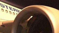 东航悉尼飞上海客机发动机故障 引擎罩被击出大洞