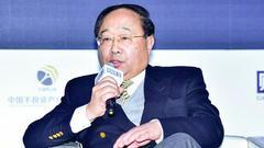 李若谷评资金外流:不应用行政手段阻止 先检讨自己