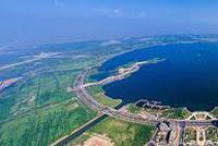 上海自贸区新片区具备自贸港特征 参照经济特区管理