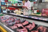 新京报:以价格波动为契机 校正猪肉供需机制弊端