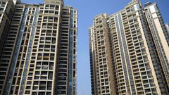 专家:限制企业购房成楼市调控新方向