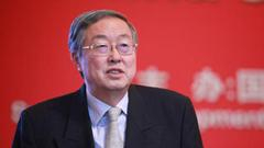 周小川:私人部门可承建金融基础设施 但需有公共精神