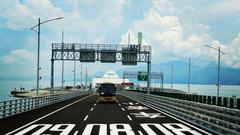 港珠澳大桥口岸今日正式通车:首辆货车10秒通关
